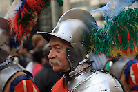 A Florentine  reenactor  is  dressed in renaissance military  attire during a city celebration.