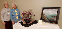 Judy Nelson and Evelyn Millar worked together to create their floral interpretation of Sunrise painted by Jaylene Bengston for display at Opechee Garden Clubs's Art 'n Bloom at Gilford Library beginning Thursday at 10 am.   (Karen Bobotas/for the Laconia Daily Sun)