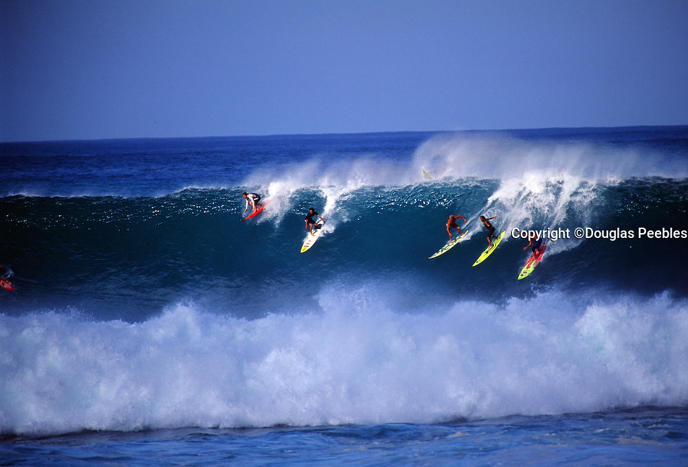 Surfing Waimea Bay, North Shore, Oahu, Hawaii