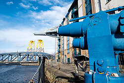 Whalers gun on display on waterside beside Water of Leith river in Leith , Scotland, United kingdom