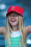 ANAHEIM, CA - APRIL 22:  A young female fan of the Los Angeles Angels of Anaheim shares a smile during the game against the Detroit Tigers at Angel Stadium on Wednesday, April 22, 2009 in Anaheim, California.  The Tigers defeated the Angels 12-10.  (Photo by Paul Spinelli/MLB Photos via Getty Images)