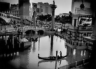 Gondolier on the Grand Canal of Venice reproduced in the desert at the Venetian Casino on the strip of Las Vegas, Nevada, USA.