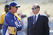 LOS ANGELES, CA - APRIL 10:  Team Manager Don Mattingly #8 of the Los Angeles Dodgers talks to former team manager Joe Torre (right) prior to the game against the Pittsburgh Pirates on Tuesday, April 10, 2012 at Dodger Stadium in Los Angeles, California. The Dodgers won the game 2-1. (Photo by Paul Spinelli/MLB Photos via Getty Images) *** Local Caption *** Don Mattingly;Joe Torre