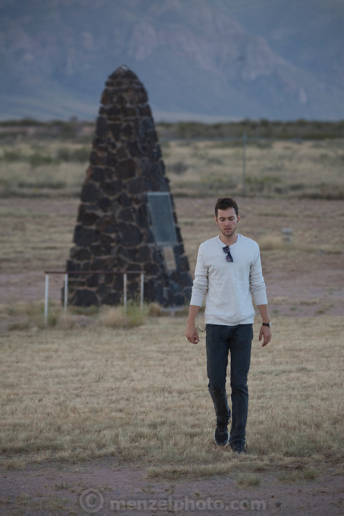 "evan Menzel at Site Trinity, ground zero, on the White Sands Missile Range in S. New Mexico. Site of the world's first atomic explosiion on August 6, 1945. The atomic bomb was developed by the Manhatten Project. The Manhattan Project refers to the effort during World War II by the United States, in collaboration with the United Kingdom, Canada, and other European physicists, to develop the first nuclear weapons. Formally designated as the Manhattan Engineering District (MED), it refers specifically to the period of the project from 1942-1946 under the control of the U.S. Army Corps of Engineers, under the administration of General Leslie R. Groves, with its scientific research directed by the American physicist J. Robert Oppenheimer. The project succeeded in developing and detonating three nuclear weapons in 1945: a test detonation on July 16 (the Trinity test) near Alamogordo, New Mexico; an enriched uranium bomb code-named ""Little Boy"" detonated on August 6 over Hiroshima, Japan; and a plutonium bomb code-named ""Fat Man"" on August 9 over Nagasaki, Japan. (http://en.wikipedia.org/wiki/Manhattan_Project) MR"