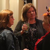 Lisa Johnson, left, and Kathy Wallace admire emcee and former Celebrity Chef Leslie Geoghegan's outfit for the Cooking Like the Stars event Sunday evening at Park Heights