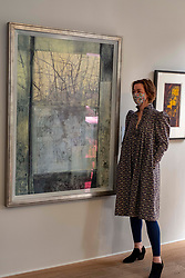 Pictured: Gallery Director Christina Jansen makes the finishing adjustments to Landscape Refection (2019) by Victoria Crowe OBE<br /><br />The Scottish Gallery on Dundas Street Edinburgh is putting on the Modern Masters Women exibition between 30 July and 29 August 2020.  Strict social distancing rules will apply  but there is plenty space to appreciate the works on display<br /><br />Ger Harley | EEm 28 July 2020