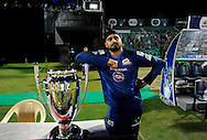 Harbhajan Singh of Mumbai Indians poses with the CLT20 2013 trophy before the start of the match 1 of the Karbonn Smart Champions League T20 (CLT20) 2013  between The Rajasthan Royals and the Mumbai Indians held at the Sawai Mansingh Stadium in Jaipur on the 21st September 2013<br /> <br /> Photo by Pal Pillai-CLT20-SPORTZPICS <br /> <br /> Use of this image is subject to the terms and conditions as outlined by the CLT20. These terms can be found by following this link:<br /> <br /> http://sportzpics.photoshelter.com/image/I0000NmDchxxGVv4