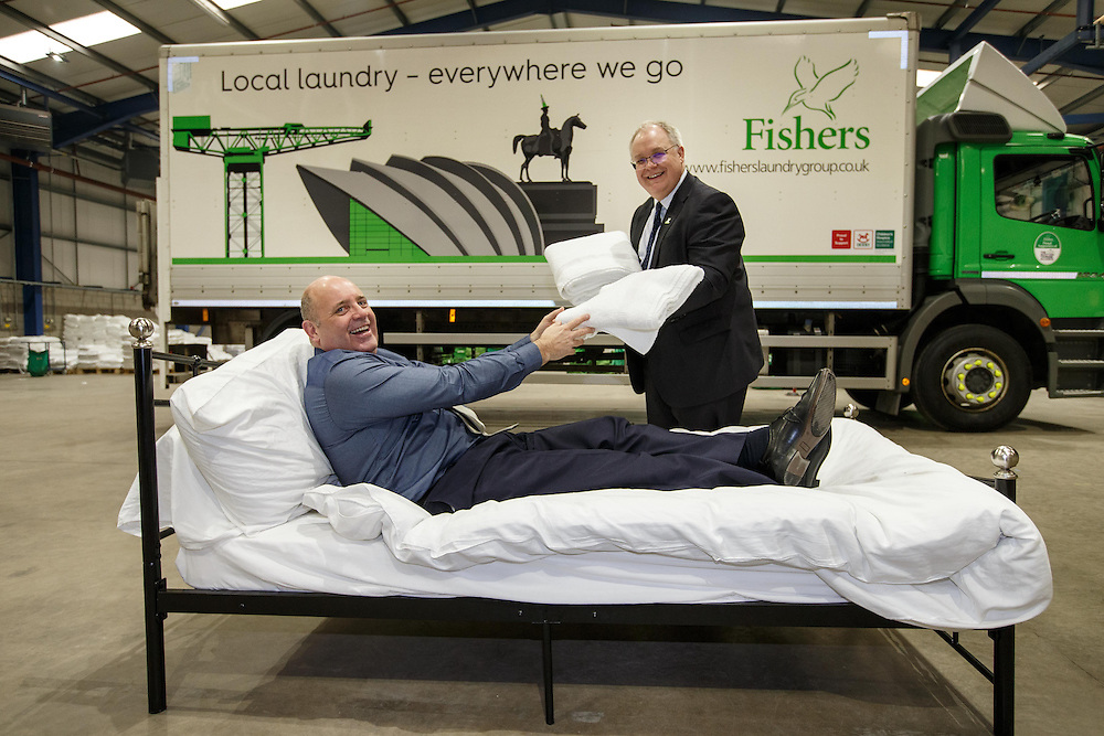 Michael Jones MD of Fishers Laundry and Marc Crothall CEO  (in bed) of The Scottish Tourism Alliance play it for laughs at Fishers' super laundry opening in Coatbridge. Picture Robert Perry 17th March 2016<br /> <br /> Please credit photo to Robert Perry<br /> <br /> Image is free to use in connection with the promotion of the above company or organisation. 'Permissions for ALL other uses need to be sought and payment make be required.<br /> <br /> <br /> Note to Editors:  This image is free to be used editorially in the promotion of the above company or organisation.  Without prejudice ALL other licences without prior consent will be deemed a breach of copyright under the 1988. Copyright Design and Patents Act  and will be subject to payment or legal action, where appropriate.<br /> www.robertperry.co.uk<br /> NB -This image is not to be distributed without the prior consent of the copyright holder.<br /> in using this image you agree to abide by terms and conditions as stated in this caption.<br /> All monies payable to Robert Perry<br /> <br /> (PLEASE DO NOT REMOVE THIS CAPTION)<br /> This image is intended for Editorial use (e.g. news). Any commercial or promotional use requires additional clearance. <br /> Copyright 2016 All rights protected.<br /> first use only<br /> contact details<br /> Robert Perry     <br /> 07702 631 477<br /> robertperryphotos@gmail.com<br />        <br /> Robert Perry reserves the right to pursue unauthorised use of this image . If you violate my intellectual property you may be liable for  damages, loss of income, and profits you derive from the use of this image.