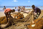 SRI LANKA, SEA COASTS fishermen pulling in nets at a village near Galle on the island's southern coast