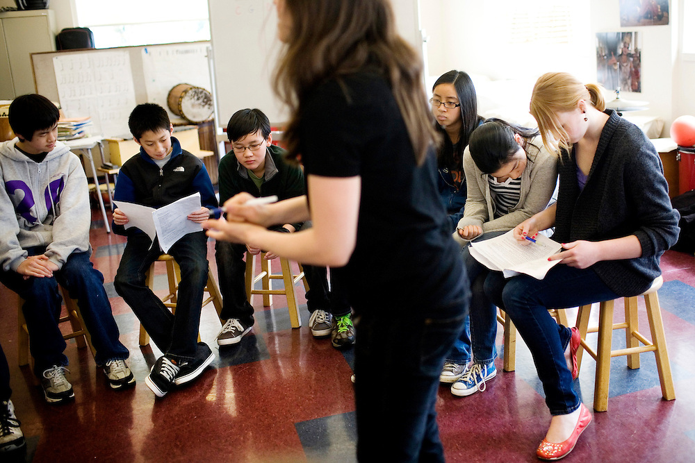 Eighth grader Tzara Geraghy, 13, far right, reviews lines while listening to her drama teacher Tamara Cooreman with her classmates  at the Chinese American International School, a prekindergarten through eighth grade Chinese-immersion private school, in San Francisco, Ca., on Tuesday, March 22, 2011. The school has become one of the most competitive to get into in San Francisco. Only a third of its students come from Asian families, and even many of those families do not speak Chinese. Yet parents are relying on Chinese language skills for their kids' future. Lianne Milton for The Wall Street Journal