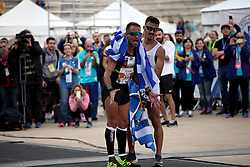 November 12, 2017 - Athens, Attica, Greece - Gkelaouzos Konstantinos and Merousis Hristoforos cheer at the finish line at the 35th Athens Classic Marathon in Athens, Greece, November 12, 2017. (Credit Image: © Giorgos Georgiou/NurPhoto via ZUMA Press)