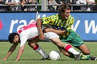 Fotball<br /> Nederland 2004/05<br /> Ado v Ajax<br /> 12. september 2004<br /> Foto: Digitalsport<br /> NORWAY ONLY<br />  geert den ouden stopt steven pienaar af