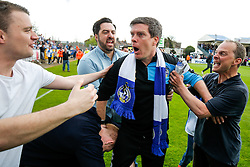 Supporters celebrate with a shocked looking Bristol Rovers Manager Darrell Clarke after Bristol Rovers win the match in injury time to secure 3rd place in League 2, back to back promotions and a place in Sky Bet League 1 for 2016/17 - Mandatory byline: Rogan Thomson/JMP - 08/03/2016 - FOOTBALL - Memorial Stadium - Bristol, England - Bristol Rovers v Dagenham & Redbridge - Sky Bet League 2.