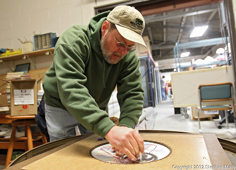 Scott Anderson of Cedar Rapids demonstrates a spirograph made with a bike chain and chainring at the Cedar Rapids Epicenter inside Cedar Valley Habitat for Humanity ReStore, 350 6th Ave SE in Cedar Rapids on Saturday, February 18, 2012. (Stephen Mally/Freelance)