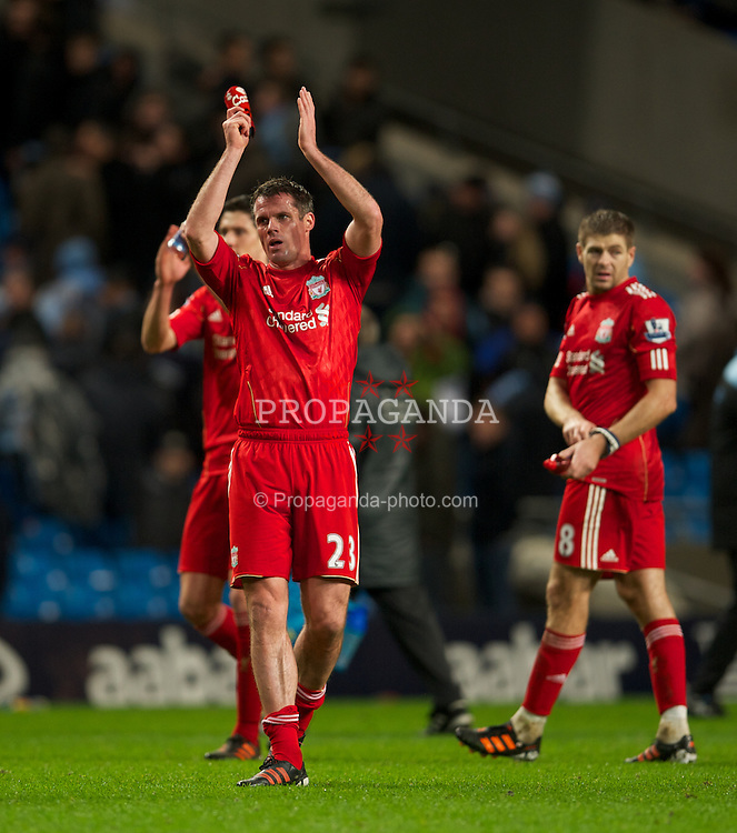 MANCHESTER, ENGLAND - Wednesday, January 11, 2012: Liverpool's Jamie Carragher applauds the travelling supporters after the 1-0 victory over Manchester City during the Football League Cup Semi-Final 1st Leg at the City of Manchester Stadium. (Pic by David Rawcliffe/Propaganda)