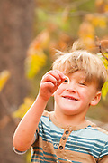 Little boy finds wood worm, McCall, Idaho. MR
