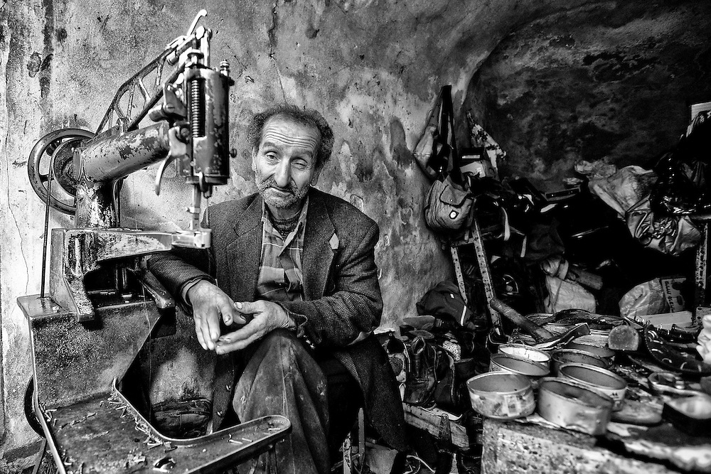 A cobbler in his shop. Hebron. Mar. 22, 2011. West Bank, Palestine.