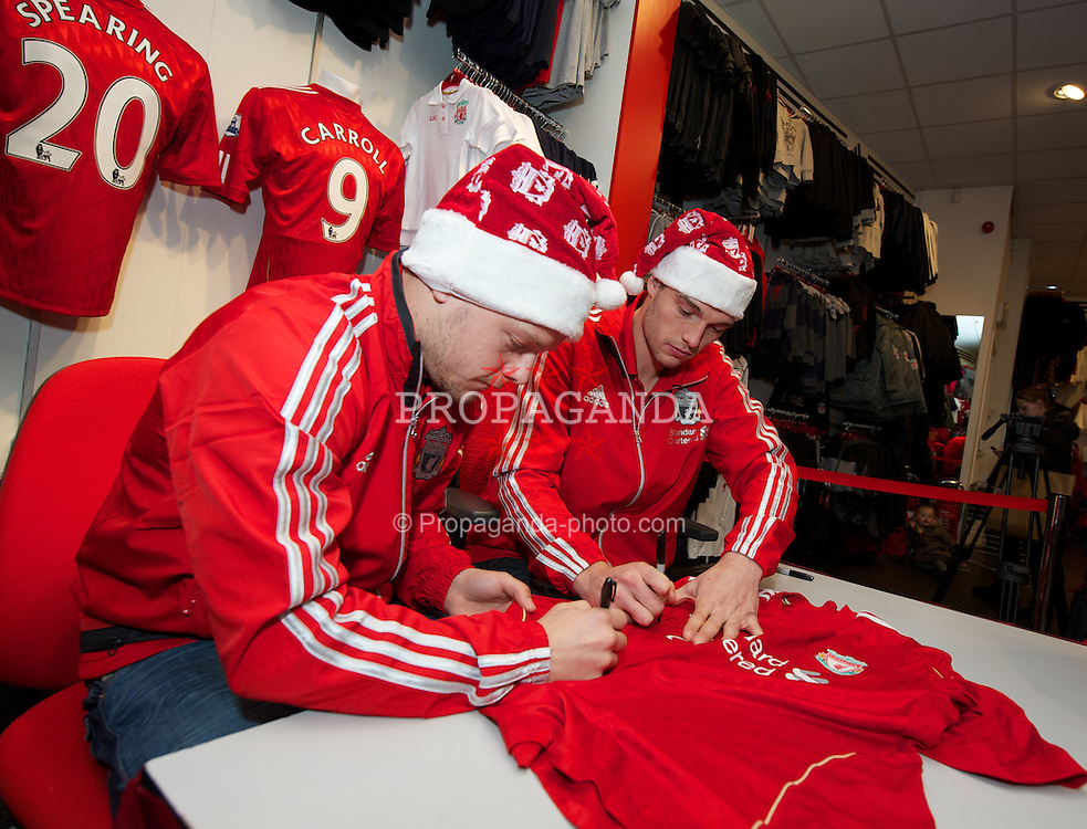 LIVERPOOL, ENGLAND - Thursday, December 15, 2011: Liverpool players Jay Spearing and Andy Carroll during a signing session at the club's city centre store. (Pic by David Rawcliffe/Propaganda)