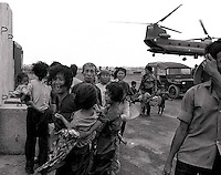 Scared refugees arrive by USA chinook helicopter after being evacuated from the besieged town of Xuan Loc as the North Vietnamese army advance. April 1975. photographed by Terry Fincher