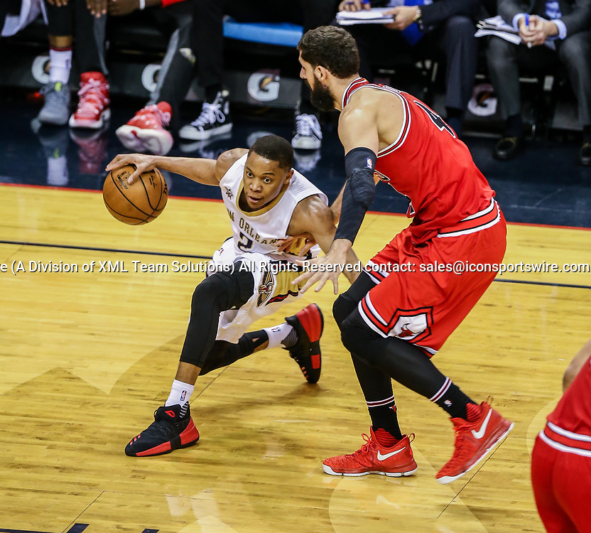 NEW ORLEANS, LA - APRIL 02: New Orleans Pelicans guard Tim Frazier (2) dribbles against Chicago Bulls forward Nikola Mirotic (44) during the game between the New Orleans Pelicans and the against the Chicago Bulls on April 2, 2017, at Smoothie King Center in New Orleans, LA.  Bull won 117-110. (Photo by Stephen Lew/Icon Sportswire)
