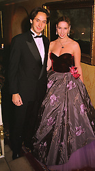 MR & MRS JULES TATTINGER members of the champagne family, at a party in London on 30th January 1999.MNP 16