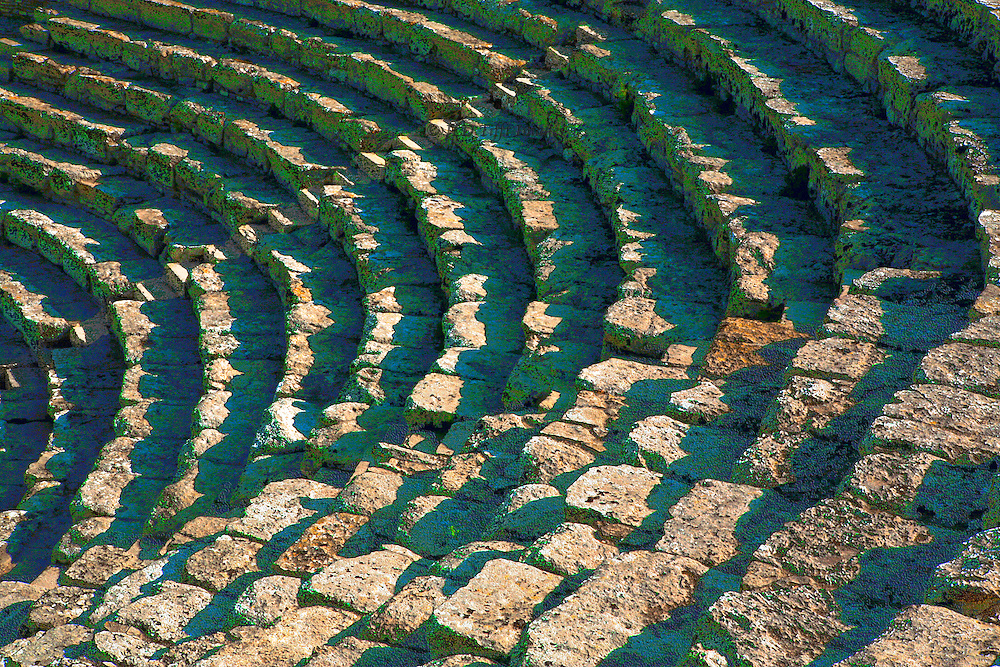 Sicily : Theater at Segesta, 3d century BC. Shadow patterns on the seats and stairs, making an abstract semicircular design.