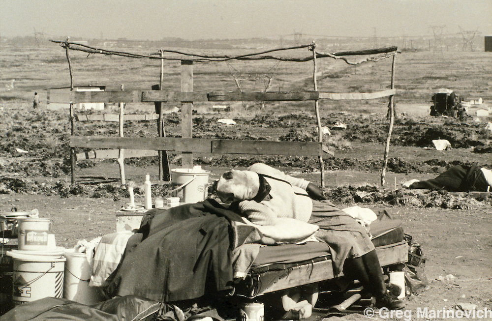 Ivory Park, Thembisa, Johannesburg, Transvaal, South Africa, 1991: A bed out in the open after police demolished the shacks and shelters of people trying to squat on open land earmarked for more formal development.