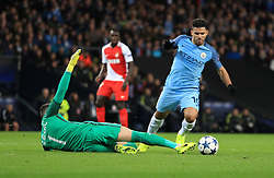 Manchester City's Sergio Aguero is challenged by  AS Monaco FC's goalkeeper Danijel Subasic to earn a yellow card for diving