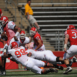 Apr 18, 2009; Piscataway, NJ, USA; Rutgers DE Jonathan Freeny (99) wraps up QB D.C. Jefferson (10) during the first half of Rutgers' Scarlet and White spring football scrimmage.