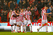 Stoke City midfielder Joe Allen (4) scores a goal and celebrates to make the score 1-0 during the EFL Sky Bet Championship match between Stoke City and Swansea City at the Bet365 Stadium, Stoke-on-Trent, England on 18 September 2018.