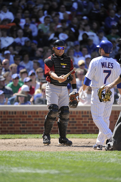 CHICAGO - MAY 16:  Ivan Rodriguez #12 of the Houston Astros hands the bat back to Aaron Miles #7 of the Chicago Cubs on May 16, 2009 at Wrigley Field in Chicago, Illinois.  The Cubs defeated the Astros 5-4.  (Photo by Ron Vesely)