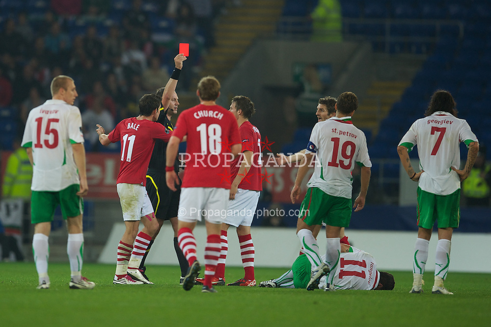 CARDIFF, WALES - Friday, October 8, 2010: Referee Jonas Eriksson shows Wales' Chris Gunter the red card and sends him off against Bulgaria during the UEFA Euro 2012 Qualifying Group G match at the Cardiff City Stadium. (Pic by David Rawcliffe/Propaganda)