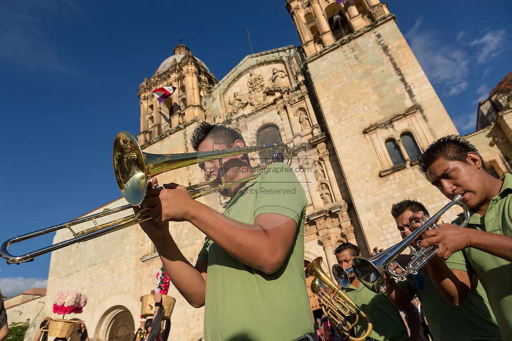 A brass band performs in front of the Santo Domingo Church during the Day of the Dead Festival known in spanish as Día de Muertos on October 257, 2014 in Oaxaca, Mexico.