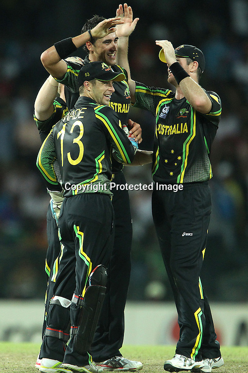 Mitchell Starc celebrates the wicket of Rohit Sharma with Matthew Wade during the ICC World Twenty20 Super 8s match between Australia and India held at the Premadasa Stadium in Colombo, Sri Lanka on the 28th September 2012<br /> <br /> Photo by Ron Gaunt/SPORTZPICS
