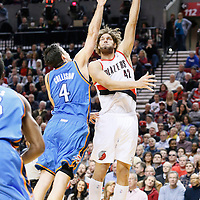 04 December 2013: Portland Trail Blazers center Robin Lopez (42) goes for the skyhook over Oklahoma City Thunder power forward Nick Collison (4) during the Portland Trail Blazers 111-104 victory over the Oklahoma City Thunder at the Moda Center, Portland, Oregon, USA.