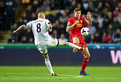 6.09.2013, Liberty Stadion, Swansea, ENG, Premier League, Swansea City vs FC Liverpool, 4. Runde, im Bild Liverpool's captain Steven Gerrard in action against Swansea City's Jonjo Shelvey during the English Premier League 4th round match between Swansea City AFC and Liverpool FC at the Liberty Stadium, Swansea, Great Britain on 2013/09/16. EXPA Pictures © 2013, PhotoCredit: EXPA/ Propagandaphoto/ David Rawcliffe<br /> <br /> ***** ATTENTION - OUT OF ENG, GBR, UK *****