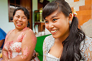 Apr. 22 - UBUD, BALI, INDONESIA: A girl at a wedding in a home in Ubud, Bali, Indonesia. Weddings in Bali have three parts, the first is the ceremony where the couple is wedded. Then the wedding party goes to the bride's family home so the bride can say goodbye to her family. Then there is a wedding reception which is quite similar to western wedding receptions.  Photo by Jack Kurtz/ZUMA Press.