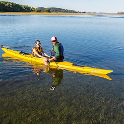 A couple on a kayak on the Essex River at the Cox Reservation in Essex, Massachusetts.