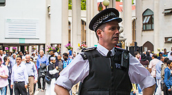 London, June 23rd 2017. Police are in evidence as Muslim worshippers gather for Friday Prayers at London Central Mosque in Regents Park, following the suspected terror attack in the early Hours of Monday June 19th when Darren Osbourne, 47, from Cardiff, now charged with terrorism-related murder, is alleged to have run down a group of Muslims in Finsbury Park PICTURED: Met Police officers keep watch as Muslims leave the mosque.