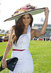 LIVERPOOL, ENGLAND, Thursday, April 7, 2011: Sonia Razzaque, 24, wearing a hat of donuts, during Ladies' Day on Day Two of the Aintree Grand National Festival at Aintree Racecourse. (Photo by David Rawcliffe/Propaganda)