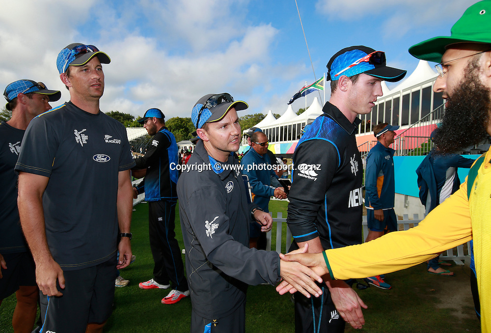 Mike Hesson coach of New Zealand shakes hands with Hashim Amla of South Africa following the ICC Cricket World Cup warm up game between New Zealand v South Africa at Hagley Oval, Christchurch. 11 February 2015 Photo: Joseph Johnson / www.photosport.co.nz