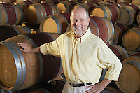 Man leaning on wine casks