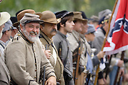 Confederate soldiers line up during a Civil War reenactment hosted by the 124th New York State Volunteers at the Orange County Farmers Museum on Sept. 23, 2006.