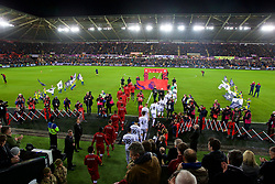 SWANSEA, WALES - Monday, January 22, 2018: Liverpool and Swansea City players walk out before the FA Premier League match between Swansea City FC and Liverpool FC at the Liberty Stadium. (Pic by David Rawcliffe/Propaganda)