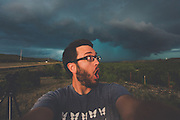 "The Storm Chaser<br /> <br /> Mike Olbinski went from photographing lightning in his backyard with a point-and-shoot camera to being a professional storm photographer—in a flash. His time-lapse storm videos have gone viral in a big way; one of them even made an appearance in a major motion picture. we spoke to Olbinski to find out how he does it.<br /> <br /> <br /> Was storm photography how you started getting into photography?<br /> I've always been a weather nut, and I would always write on Facebook that I should be a meteorologist, and why didn't I go to school for that, and all that kind of stuff. So I always liked that, and I just started looking at photography, and started following some guys who were doing lightning photography, and thought, ""that looks like so much fun."" So I took this little camera out, and would just hold the shutter down, and it would just go click, click, click, and I would try to take pictures of lightning, and I got a few that were ok, and then one night I got an amazing one, and I couldn't believe it. Then I got on the local news, and I was hooked from there. I told my wife, ""I've got to get a camera that can do long exposures,"" so we sold all of our DVDs on eBay for almost $500, and I bought a Canon Rebel and just started from there.<br /> <br /> <br /> Do you remember the first storm photo that you sold?<br /> Once I started getting into time lapses, that was when everything really took off for me, because selling prints is really hard, unless you're a name, and getting yourself a name takes time. People started licensing footage for stuff, and that's when I started making money. The latest big thing for me was this supercell I shot last June, in Texas, and it was just kind of rotating dust, and lots of colors, and that went viral. I didn't think that would happen to me again after my dust storm video in 2011, which went viral; that was a once-in-a-lifetime thing. But this was even bigger, and was actually the #1 time-lapse video on Vimeo last year. And the biggest thing"