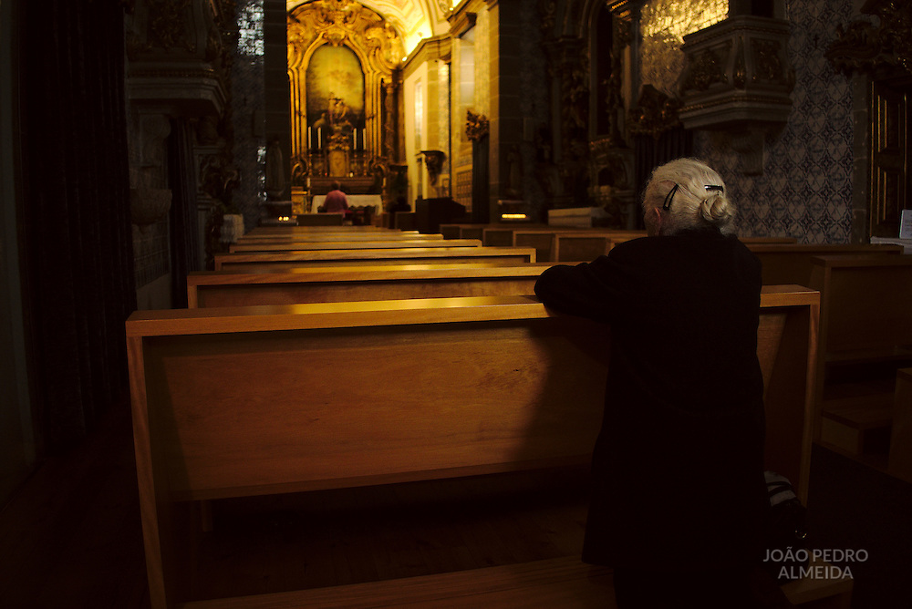 Elderly woman praying on the morning of Good Friday