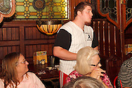 "Ben Fox as Rusty Sparks (standing) during Mayhem & Mystery's production of ""Baseball Battle"" at the Spaghetti Warehouse in downtown Dayton, Monday, May 7, 2012."