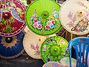 "07 APRIL 2013 - CHIANG MAI, CHIANG MAI, THAILAND:  Decorative paper umbrellas for sale on Chiang Mai's ""Walking Street"" market. The Walking Street Market starts at Thapae Gate and runs along the length of Ratchadamnoen Road through the heart of the Old City and has become a Chiang Mai institution. Chiang Mai is the largest town in northern Thailand and is popular with tourists and backpackers.       PHOTO BY JACK KURTZ"