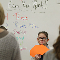 Cloe Hollis waits her turn to describe the shape she is holding during Wednesday's math/science bootcamp at North Pontotoc Elementary SChool.