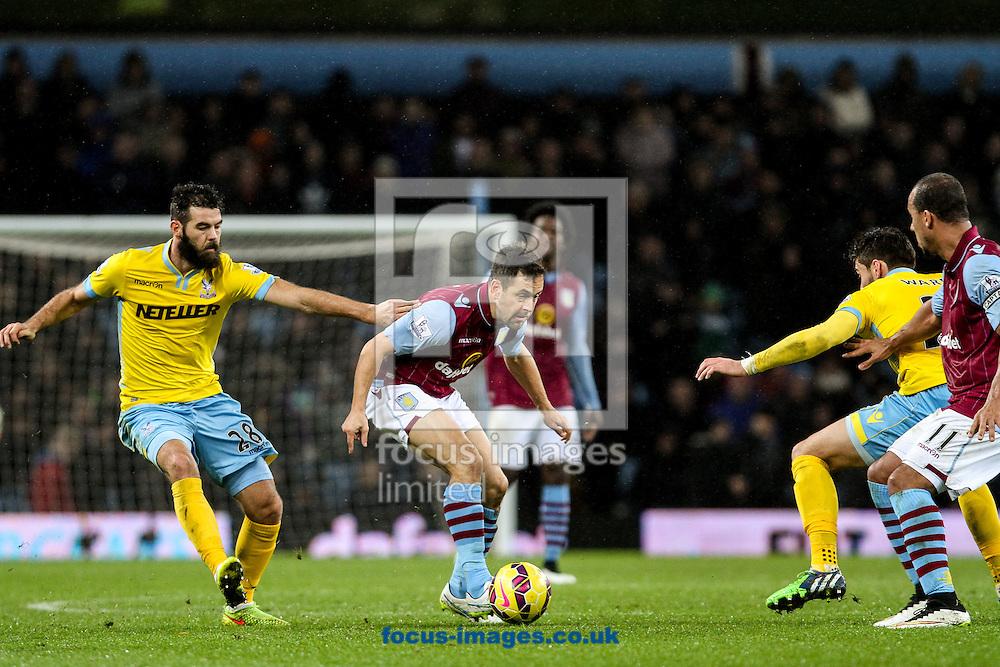 Joe Cole of Aston Villa (centre) during the Barclays Premier League match at Villa Park, Birmingham<br /> Picture by Andy Kearns/Focus Images Ltd 0781 864 4264<br /> 01/01/2015